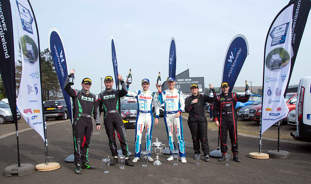 Top-3-finishers-celebrate-with-trophies